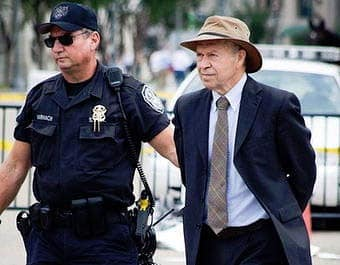"James Hansen being arrested at a protest against the Keystone XL pipeline, which he calls ""the fuse to the biggest carbon bomb on the planet,"" because it would carry tar sands crude."